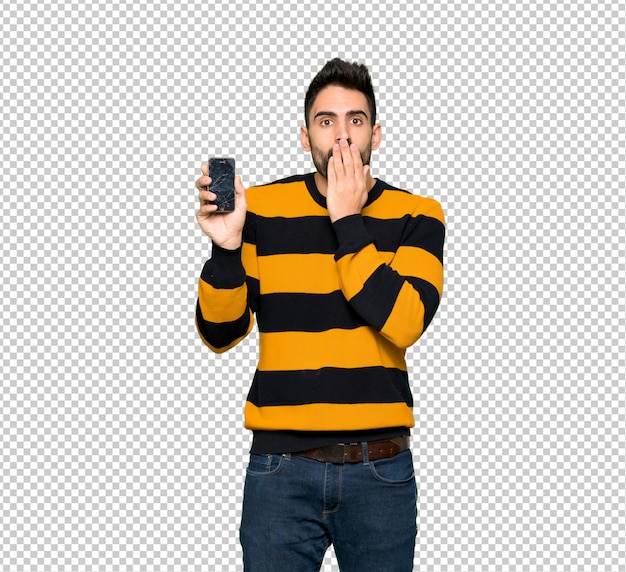 Handsome man with striped sweater with troubled holding broken smartphone