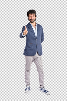 Handsome man with thumb up over white background