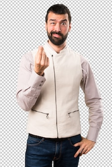 Handsome man with vest making money gesture