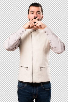 Handsome man with vest making silence gesture