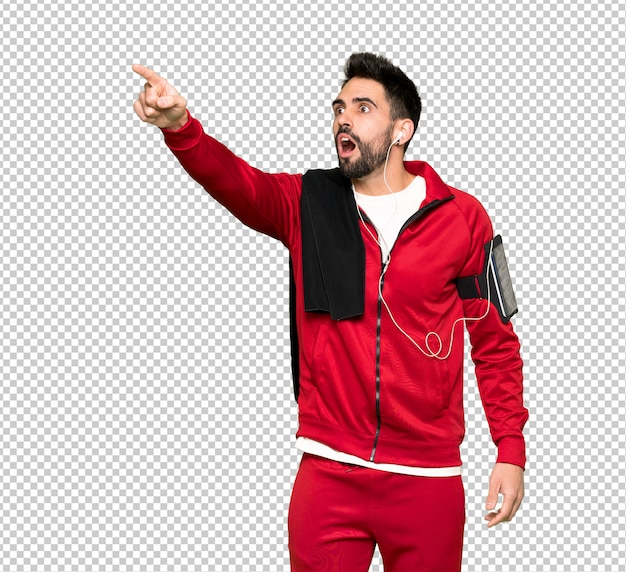 Handsome sportman pointing away
