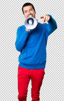 Handsome young man holding a megaphone