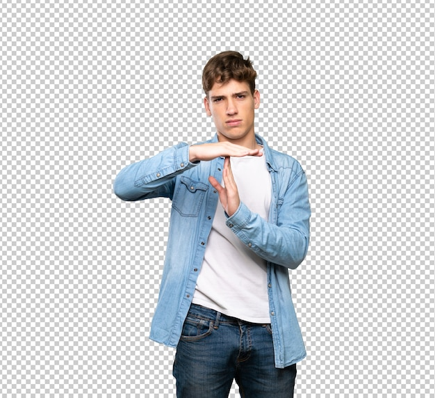 Handsome young man making time out gesture
