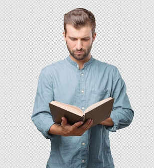 Handsome young man reading in book