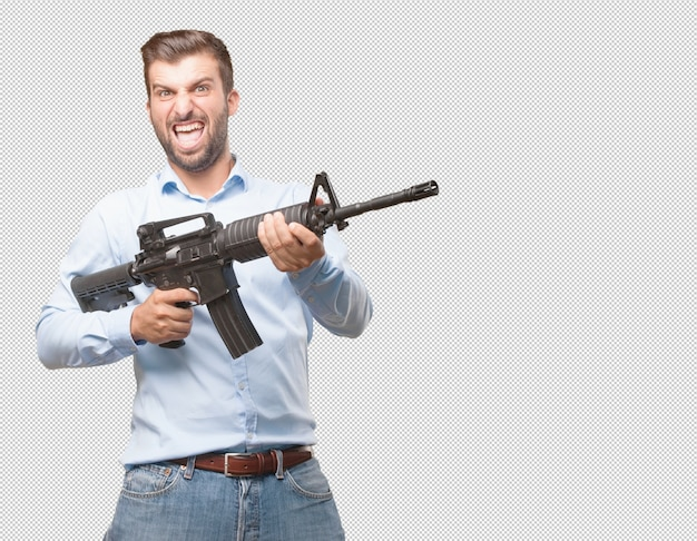 Handsome young man with assault rifle