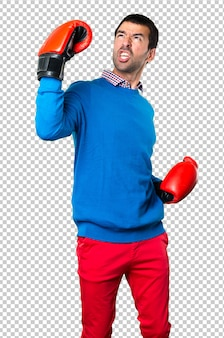 Handsome young man with boxing gloves