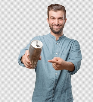 Handsome young man with can