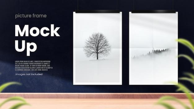 Hanging poster mockups on dark blue wall in modern interior