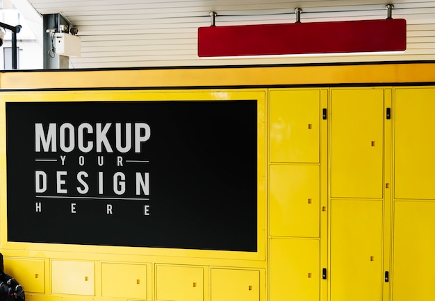 Hanging red sign mockup above yellow luggage locker