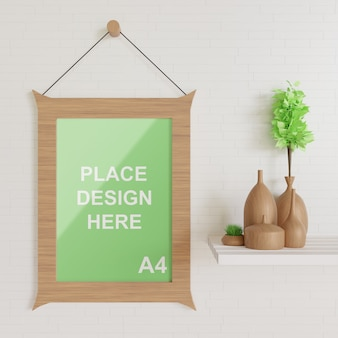 Hanging wooden frame mockup on the wall