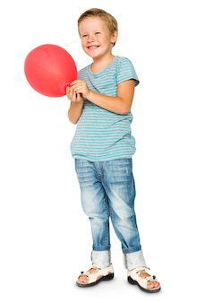 Happiness little boy smiling and holding balloon studio portrait
