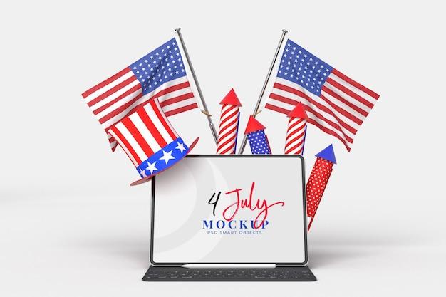 7 월 미국 독립 기념일 및 장식 및 미국 국기가있는 태블릿 모형의 행복한 4 일