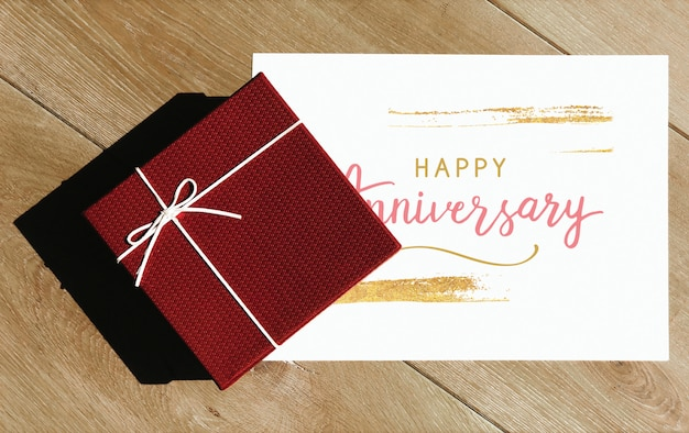 Happy anniversary card mockup with a gift box