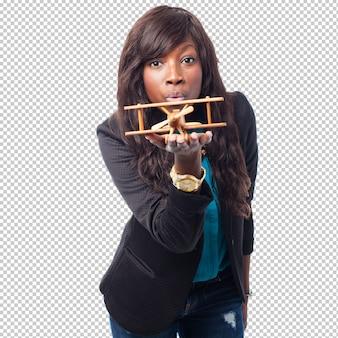Happy black woman with biplane