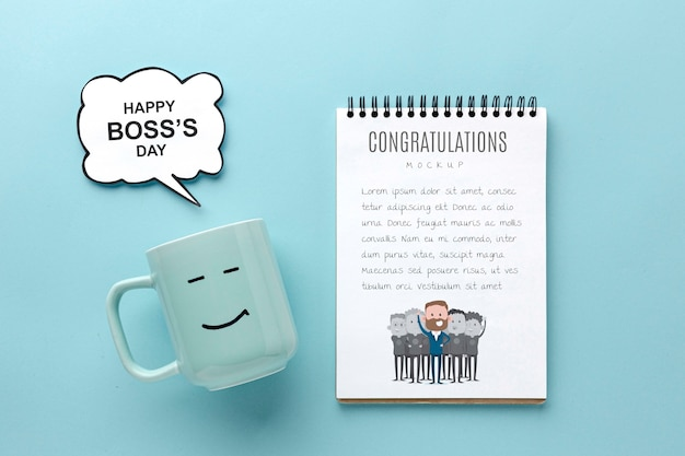 Happy boss's day with mug and notebook
