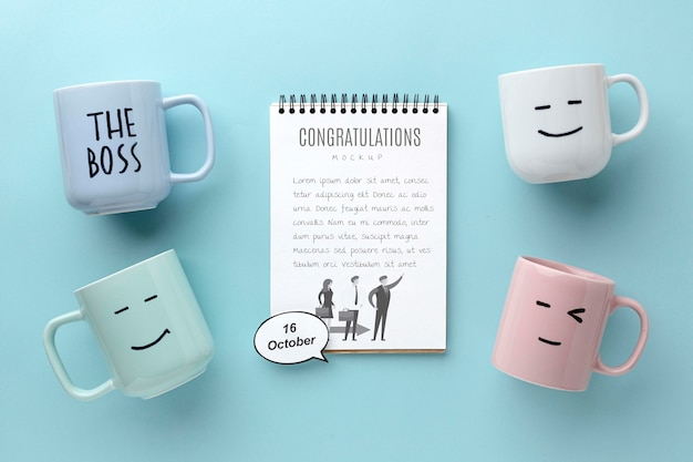Happy boss's day with notebook and mugs