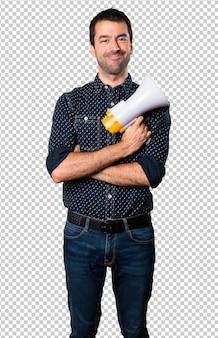 Happy brunette man holding a megaphone