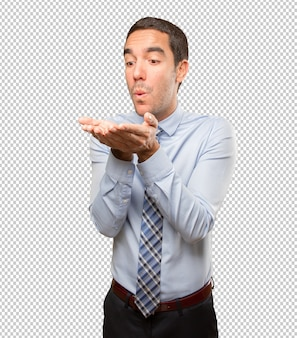 Happy businessman sending a kiss