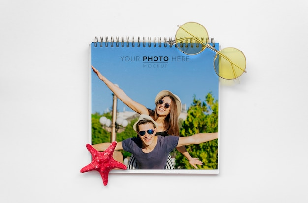 Happy couple cover of notepad travel concept