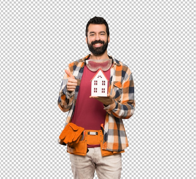Happy craftsmen man holding a little house