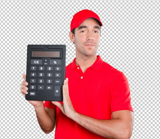 Happy delivery man holding a calculator