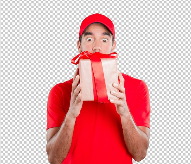 Happy delivery man holding a gift