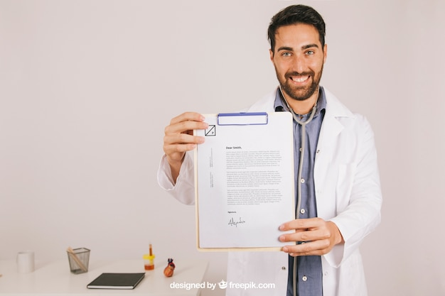 Happy doctor with clipboard in the clinic