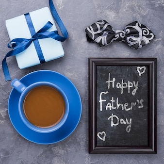 Happy fathers day with frame and coffee cup