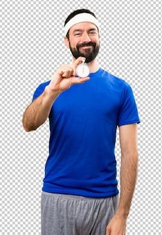 Happy funny sportsman holding vintage chronometer