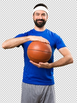 Happy funny sportsman with ball of basketball
