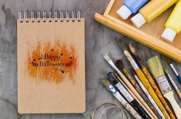 Happy halloween message on notebook