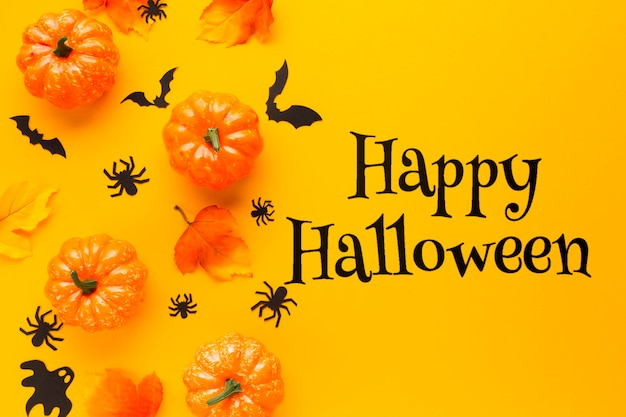 Happy halloween message with pumpkins