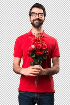 Happy handsome man holding flowers