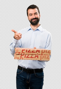 Happy handsome man with beard holding pizzas