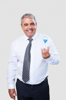 Happy mature man holding a sand timer