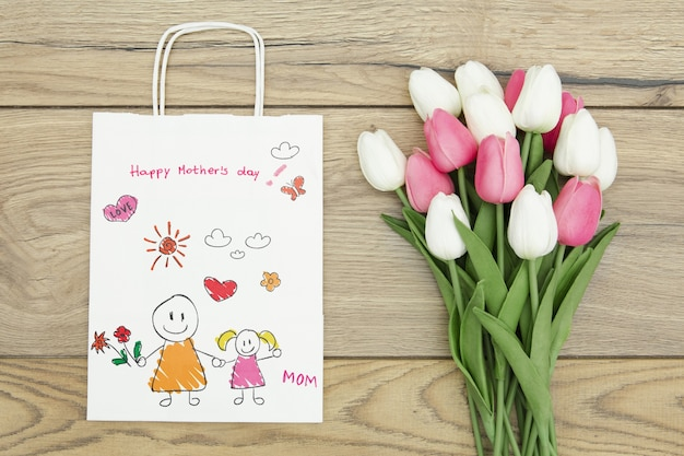 Happy mother's day with gift bag and tulips