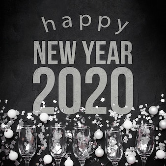 Happy new year 2020 with balls and glasses