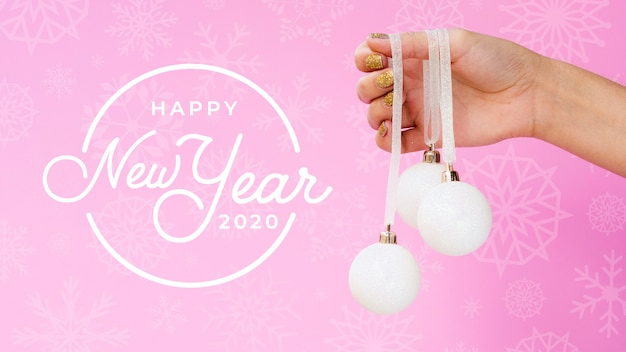 Happy new year 2020 with white christmas ball on pink background
