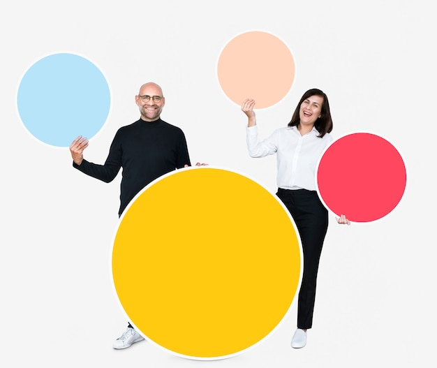 Happy people holding colorful round boards
