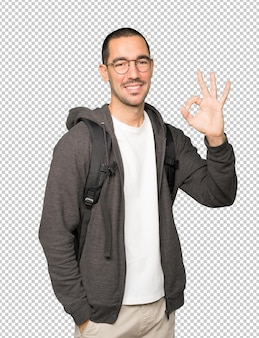Happy student doing an all right gesture