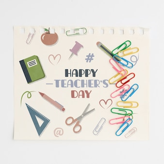 Happy teachers day with school supplies top view