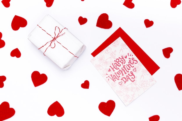 Happy valentines day card next to wrapped gift