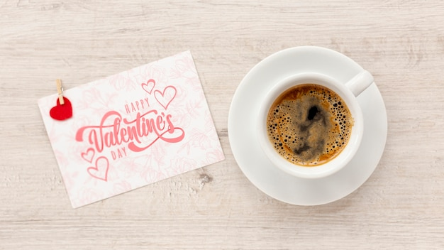 Happy valentines day lettering with cup of coffee