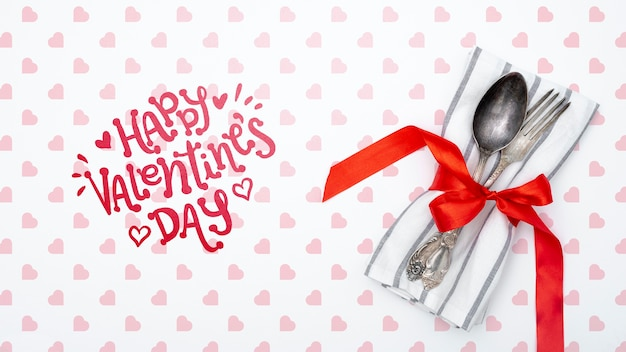 Happy valentines day lettering with tableware