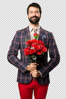 Happy well dressed man holding flowers