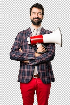 Happy well dressed man holding a megaphone