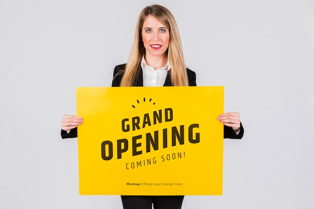 Happy woman holding a placard concept mock-up