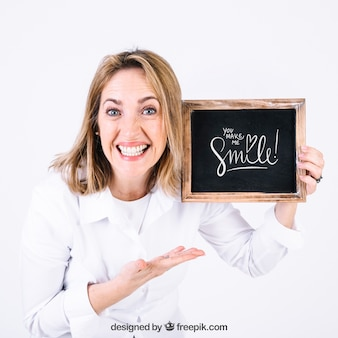 Happy woman presenting slate