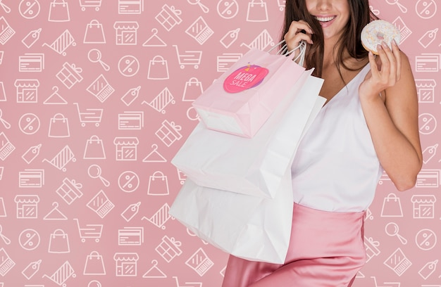 Happy woman with shopping bags copy-space