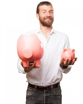 Happy worker with two piggy banks